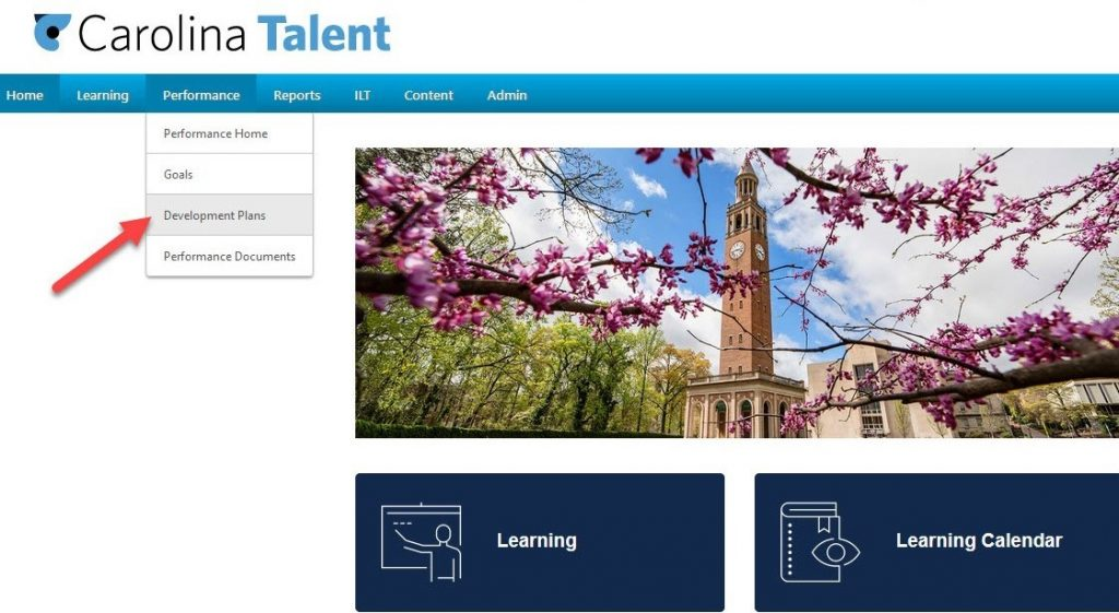 Step 1 Screenshot of Carolina Talent Home page with the drop down for 'Development Plan' indicated with a red arrow and grey background